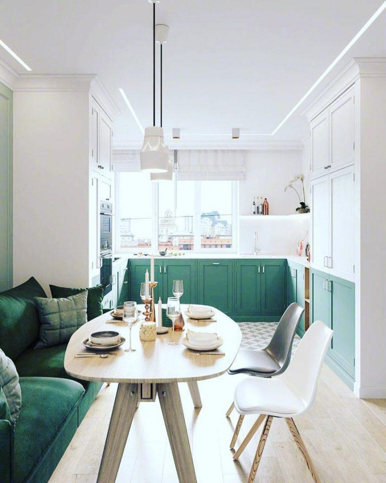 Cocina abierta con mesa en el comedor para comer en el sofa · luladu